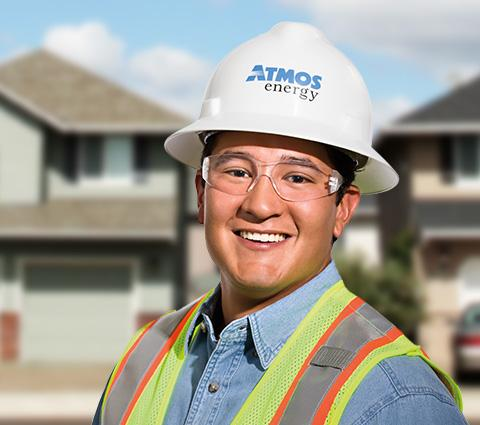 Atmos Energy employee in hard hat, safety goggles and vest.