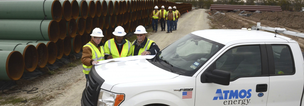 Atmos Energy Technicians huddled on a worksite conducting a Questions and Answer session.